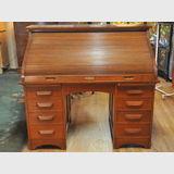 Rolltop Desk   Period: c1920s   Material: Silky Oak