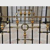 Queen Brass, Iron & Porcelain Bed | Period: Victorian 1895 | Material: Brass, iron & porcelain