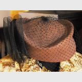 Felt Hat | Period: c1970s | Make: Dolman | Material: Brown felt with black netting