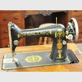 Singer Sewing Machine | Period: c1917 | Make: Singer | Material: Various metals with American Oak case.