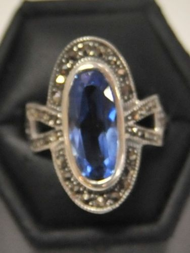 Blue Topaz Ring   Period: New   Material: Sterling Silver, Marcasite and Topaz