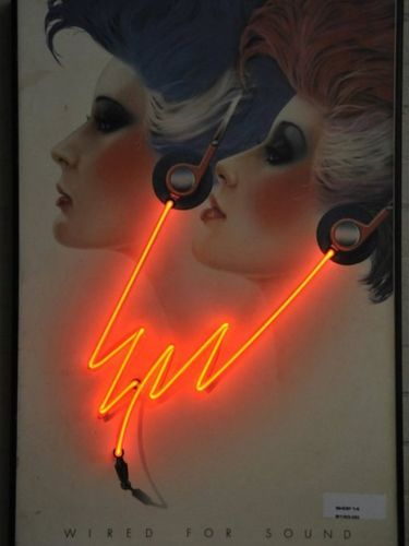 "Print with Neon - | Period: c1980 | Print captioned ""Wired for Sound"" with Neon headphone wires"
