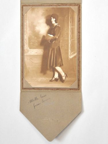 Flapper Girl Photograph | Period: 1925 | Make: Sidney Riley, Brisbane | Material: Sepia photograph mounted in cardboard presentation folder