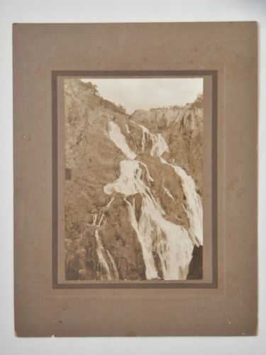 Barron Falls Photograph | Period: 1920s | Make: The Regent Commercial Co, Brisbane | Material: Sepia photograph on board.