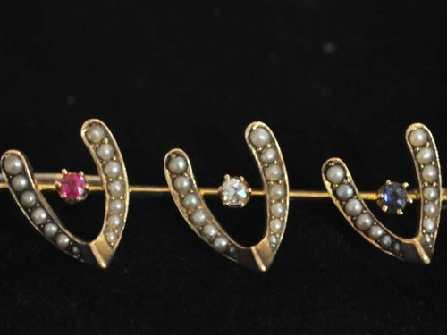 Wish Bone Brooch | Period: Edwardian c1910 | Make: Handmade. | Material: 18ct gold, sapphire, ruby, diamond and seed pearls.