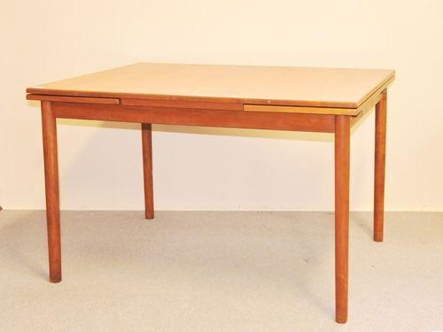 Retro Extension Table | Period: Retro 1960s | Make: Parker (attrib.) | Material: Teak | Table shown closed.