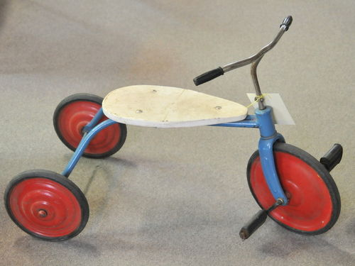 Tricycle | Period: c1920s | Material: Steel with wood seat.
